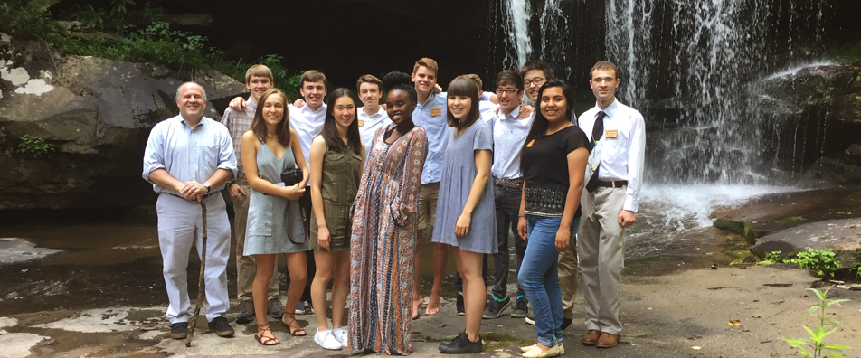 Students pose near the waterfall at Bear Run.